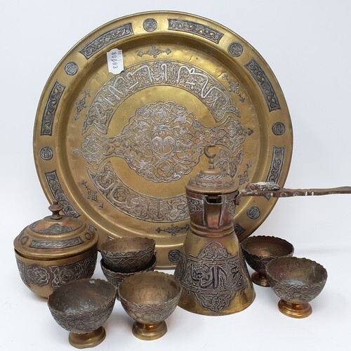 An Islamic brass and silver coloured metal inlaid coffee set...