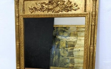 Carved Wood Gilt Painted Wall Mirror. Carved flower bas