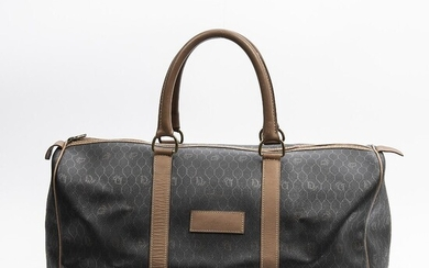 """Christian Dior: """"Vintage Boston Bag"""" A travel bag of black and dark brown coated canvas with brown leather trimmings. – Bruun Rasmussen Auctioneers of Fine Art"""