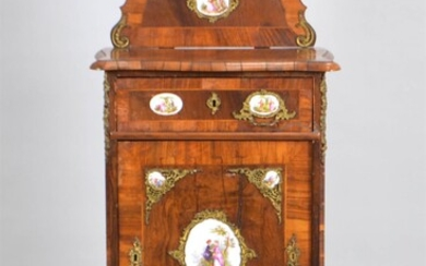 GERMAN ROCOCO STYLE PORCELAIN AND GILT METAL MOUNTED WALNUT CABINET