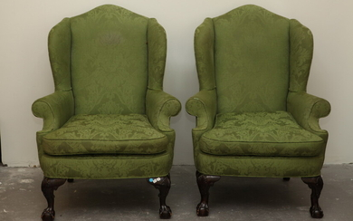 PAIR CHIPPENDALE STYLE CARVED MAHOGANY UPHOLSTERED WING CHAIRS. Ball-and-claw feet...