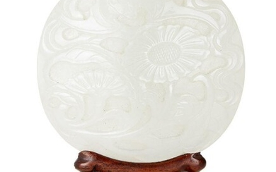 Property of a Gentleman (lots 36-85) A Chinese white jade oval 'bat and chrysanthemum' plaque, 18th century, finely carved with a bat in flight above two flowering chrysanthemum stems, 7.5x7cm, on carved wood stand