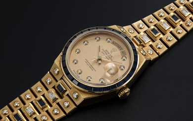 "ROLEX ""MECCANO"" REF. 19168, A GOLD DAY-DATE OYSTERQUARTZ SET WITH DIAMONDS AND SAPPHIRES"