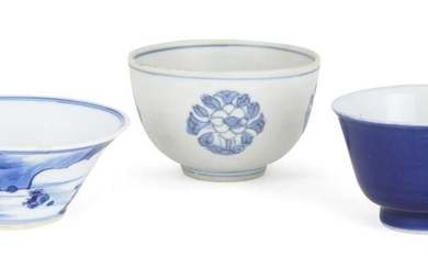 Three Chinese porcelain teabowls, 17th-19th century, one painted with a scholar sat atop a rocky outcrop by the sea, another shipwreck teabowl decorated with four flowerheads, the third a blue monochrome teabowl, 3.4cm-4.5cm high (3)