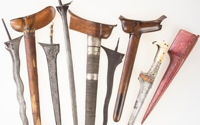 Three Indonesian krisses without hilts and a kris blade, added...