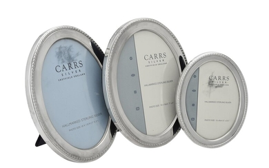 Three silver mounted oval photo frames by Carr's of Sheffield Ltd.