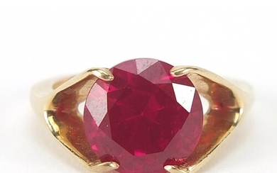Unmarked gold ruby solitaire ring, the stone approximately 1...