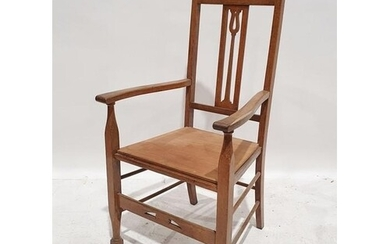 20th century oak carver chair in the Arts & Crafts manner