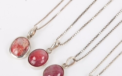 4 modern silver-mounted cabochon ruby pendant necklaces, on ...