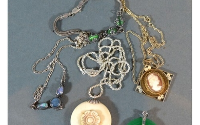 A Chinese Jade Set Pendant together with two other necklaces...