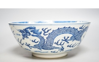 A Chinese blue and white dragon bowl, Kangxi mark, late 19...