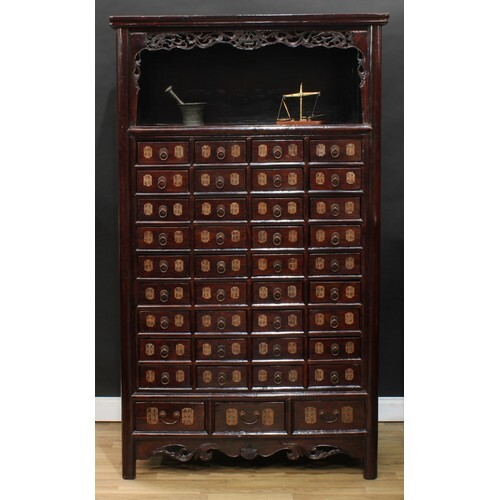 A Chinese hardwood apothecary medicine chest, moulded cornic...