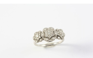 A DIAMOND TRIPLE CLUSTER RING set overall with circular-cut ...