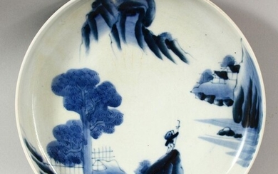 A JAPANESE BLUE AND WHITE PORCELAIN DISH, painted with a fig...