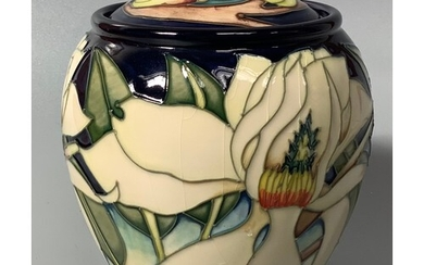 A Moorcroft pottery vase and cover of ovoid form decorated i...