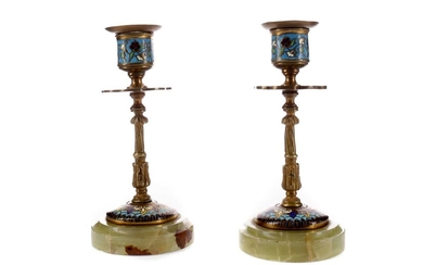 A PAIR OF LATE 19TH CENTURY BRASS AND CHAMPLEVÉ ENAMEL CANDLESTICKS