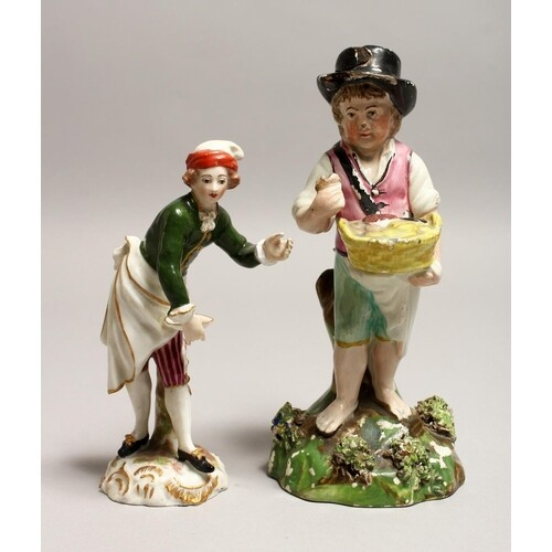 A SMALL DERBY PORCELAIN FIGURE of a young lady holding a pla...
