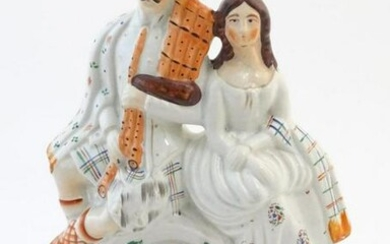 A Staffordshire flat back figural group depicting a