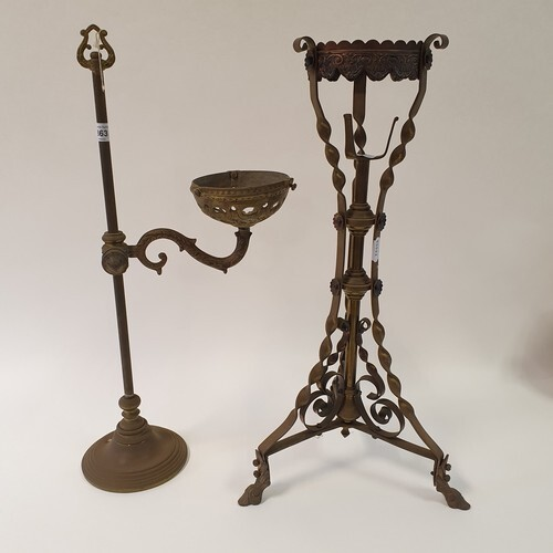 A copper and brass oil lamp stand, 56 cm high, and a brass a...