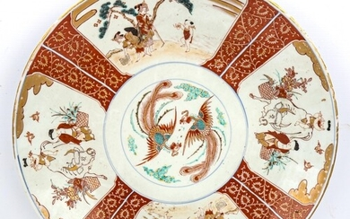 A large Chinese porcelain charger, with hand painted and gil...