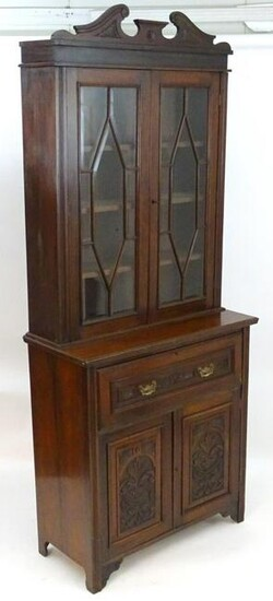 A late 19thC / early 20thC mahogany secretaire bookcase