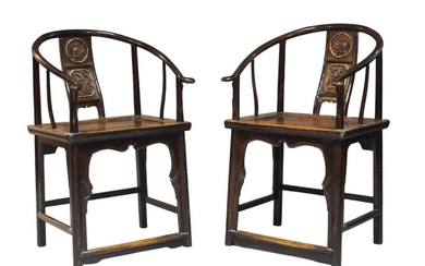 A pair of Chinese horseshoe back chairs, quanyi, early 20th century, with carved back panel decorated with a vase of flowers and a vase of fruit, 95cm high