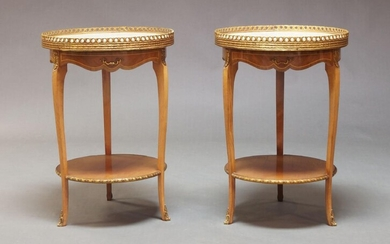 A pair of Louis XVI taste kingwood and gilt metal mounted gueridons, second half 20th Century, with circular white marble top and pierced gallery, above single frieze drawer, over circular undertier on square cut curvilinear legs, each 66.5cm high...