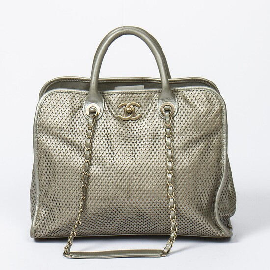 """Chanel: An """"Up In The Air"""" bag of grey perforated leather, leather trimmings, gold tone hardware, two handles and two chain shoulder straps. – Bruun Rasmussen Auctioneers of Fine Art"""