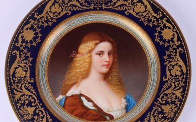 Fine quality porcelain gilded cabinet plate with a female portrait signed F. Wagner. Factory Pirkenhammer. Bohemia, 1890s.