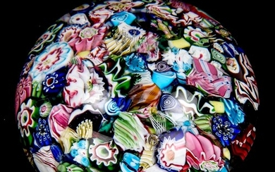 Millefiori glass paperweight with twisted canes, diameter 7....