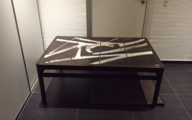 NOT SOLD. Ole Bjørn Krüger: A coffee table of stained oak. Table top inlaid with...