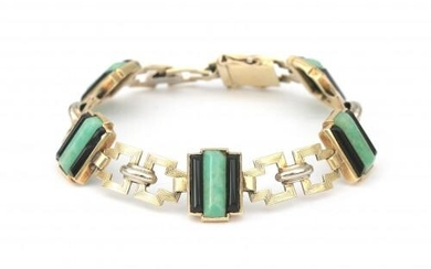 A 14 karat gold Art Deco bracelet with amazonite and onyx. Composed of rectangular links, alternated with amazonite and onyx set links. Gross weight: 18 g.