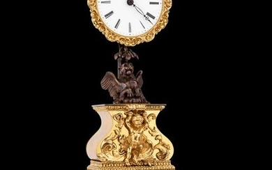 A French Gilt and Patinated Bronze Mystery Clock, with