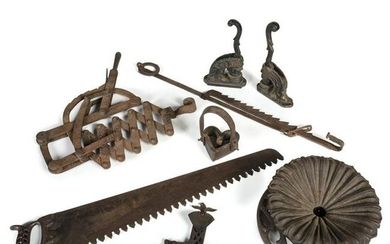 A Group of Cast Iron Tools