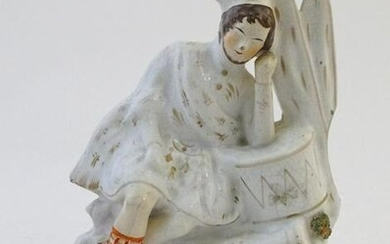 A Staffordshire pottery flat back figure depicting a