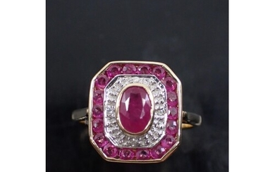 A diamond and ruby cluster ring, set in gold, showing as fi...