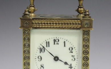 A late 19th/early 20th century lacquered brass carriage timepiece with eight day movement, the dial