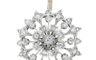 A late Victorian silver and gold, circular-cut diamond floral pendant.
