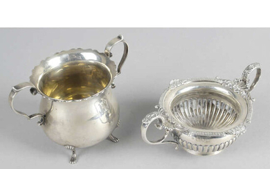 A late Victorian silver small twin-handled bowl, together with an early George V example. (2).