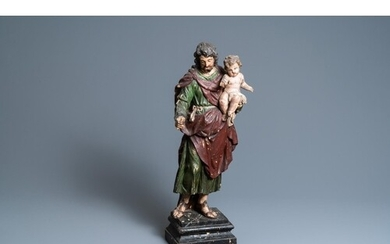 A polychromed wooden figure of Saint Joseph with child, 2nd ...