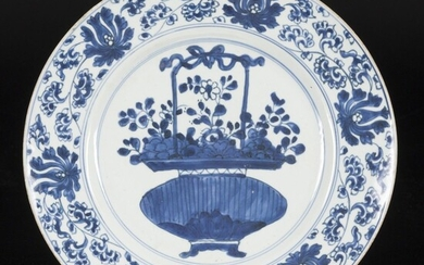A porcelain plate with decoration of a vase with flowers, China, Kangxi.