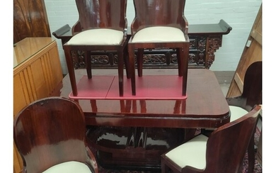 An Art Deco dining suite comprising rounded rectangular tabl...