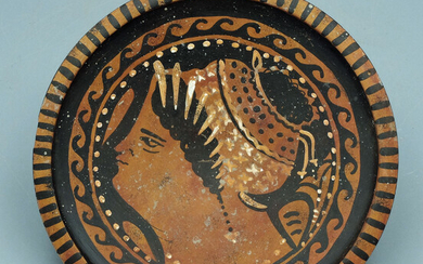 Greek red-figure plate featuring the head of a woman