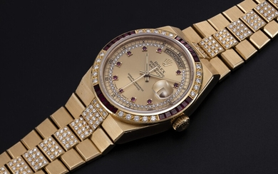 ROLEX, A GOLD OYSTERQUARTZ DAY-DATE WITH A DIAMOND AND RUBY-SET BEZEL AND INTEGRATED GOLD 'KARAT' BRACELET, REF. 19188