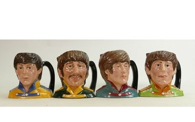 Royal Doulton set of mid size character Jugs The Beatles: Co...
