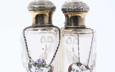 Set of four early 20th century French silver and glass toiletry bottles, with gilded decoration, each cap engraved 'Florence'