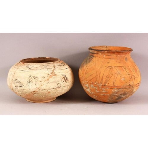 TWO INDUS VALLEY CERAMIC VASES, both painted with animals an...