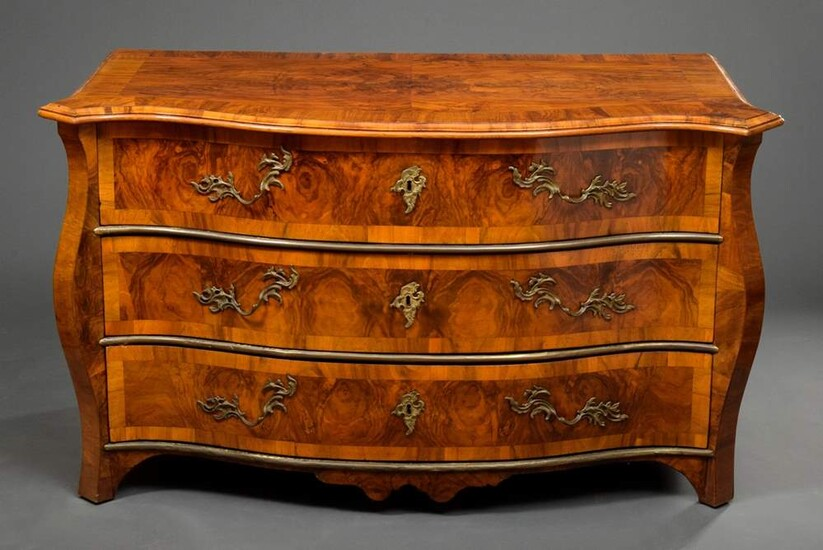Three-bay chest of drawers with curved front and brass bands,...