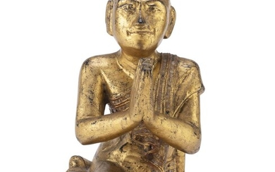 A BURMESE BLACK AND GOLD LACQUERED WOOD SCULPTURE LATE 19TH EARLY 20TH CENTURY.