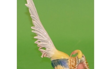 A Continental China Figure of a bird on multicoloured ground...